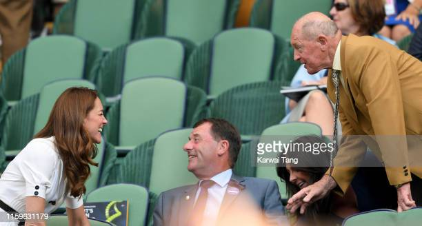 Catherine, Duchess of Cambridge, Wimbledon Chairman Philip Brook and Geoffrey Boycott share a joke as they attend day 2 of the Wimbledon Tennis...