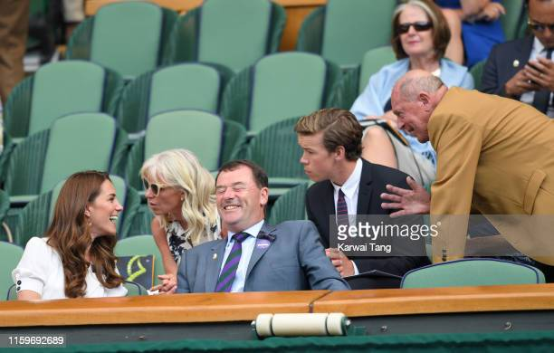 Catherine, Duchess of Cambridge, Wimbledon Chairman Philip Brook and Geoffrey Boycott share a joke as they attend day two of the Wimbledon Tennis...