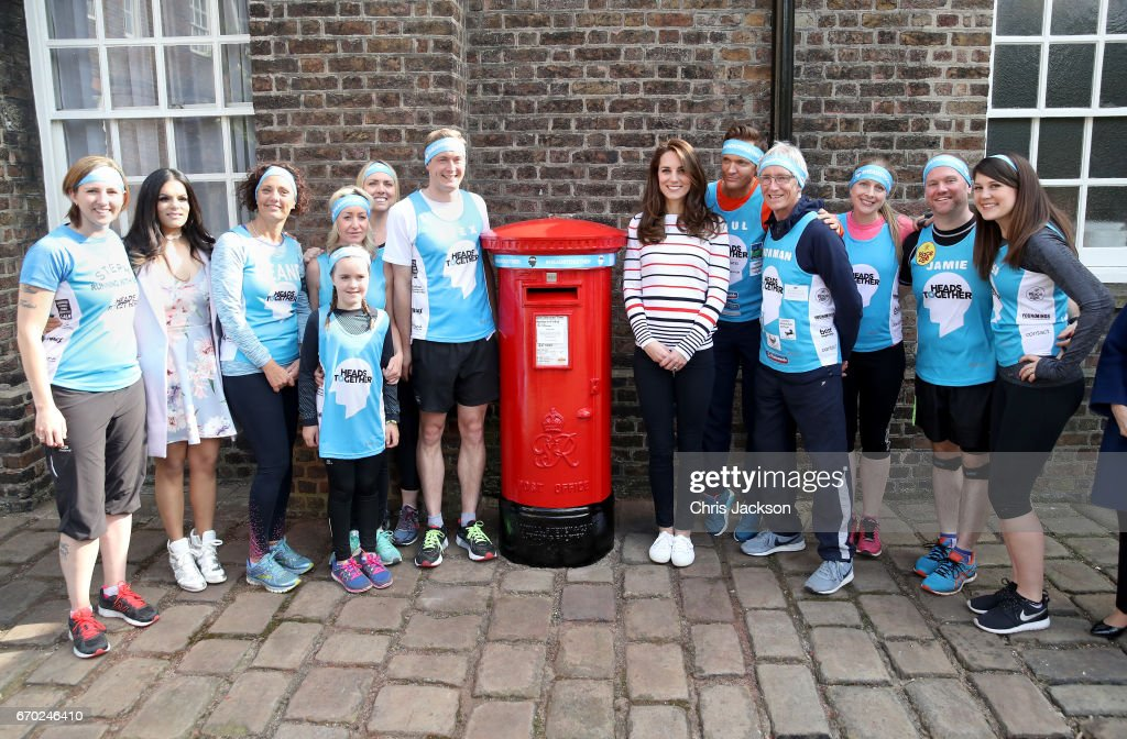Catherine, Duchess of Cambridge (centre right) with Alex Stanley (centre left) and runners as they put a Heads Together headband onto the Kensington Palace post-box in support of the Royal Mail wrapping 70 post-boxes that line the 2017 Virgin Money London Marathon route ahead of a reception for Team Heads Together, at Kensington Palace on April 19, 2017 in London, England. Heads Together is spearheaded by the Duke and Duchess of Cambridge and Prince Harry, in partnership with eight leading mental health charities that are tackling stigma, raising awareness, and providing vital help for people with mental health problems.