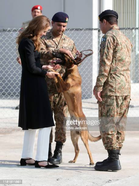 Catherine Duchess of Cambridge with Captain Aqeel of the Pakistan Army and Belgian Malinois dog Tutu as she visits an Army Canine Centre with Prince...
