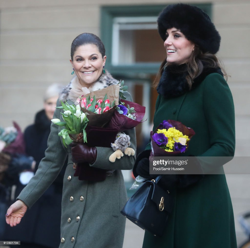 Catherine, Duchess of Cambridge with Crown Princess Victoria of Sweden walk through the cobbled streets of Stockholm from the Royal Palace to the Nobel Museum during day one of their Royal visit to Sweden and Norway on January 30, 2018 in Stockholm, Sweden.