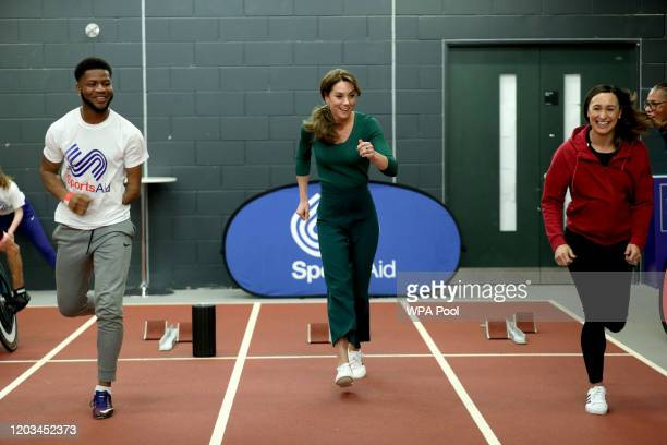 Catherine Duchess of Cambridge with heptathlete Jessica EnnisHill during a SportsAid Stars event at the London Stadium in Stratford on February 26...