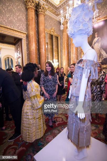 Catherine Duchess of Cambridge with 'NKWO' from Nigeria attend The Commonwealth Fashion Exchange Reception at Buckingham Palace on February 19 2018...