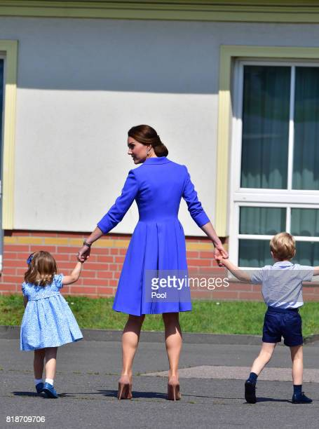 Catherine Duchess of Cambridge with Prince George of Cambridge and Princess Charlotte of Cambridge as they arrive at Berlin Tegel Airport during an...