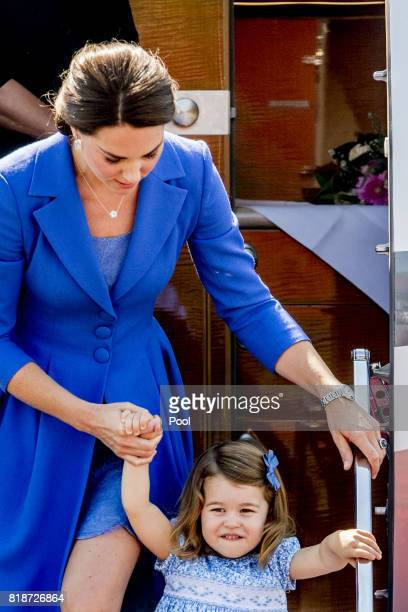 Catherine Duchess of Cambridge with Princess Charlotte of Cambridge as they arrive at Berlin Tegel Airport during an official visit to Poland and...