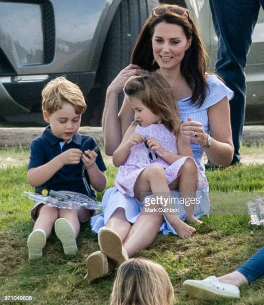 Catherine Duchess of Cambridge with Princess Charlotte of Cambridge and Prince George of Cambridge during the Maserati Royal Charity Polo Trophy at...