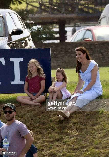Catherine Duchess of Cambridge with Princess Charlotte of Cambridge and Savannah Phillips during the Maserati Royal Charity Polo on June 10 2018 in...