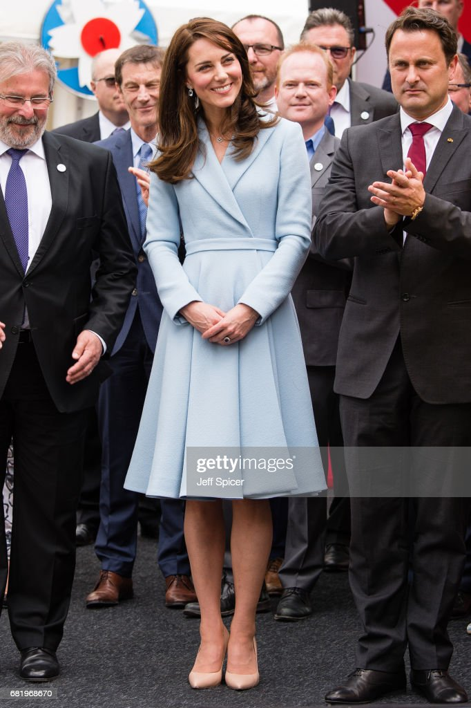 Catherine, Duchess of Cambridge (L) with Xavier Bettel, Prime Minister of Luxembourg (R), tours a cycling themed festival and unveils a mural of British cyclist Tom Simpson and Luxembourgish cycling legend Charly Gaul during a one day visit to Luxembourg at Place de Clairfontaine on May 11, 2017 in Luxembourg, Luxembourg.