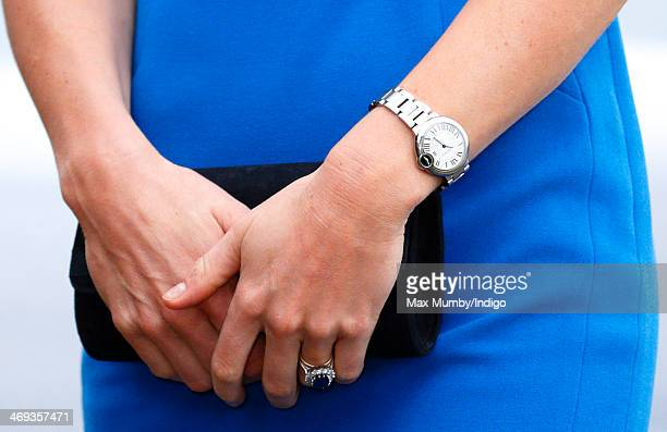 Catherine Duchess of Cambridge's Cartier watch and clutch bag seen as she arrives at Northolt High School to officially open The ICAP Art Room on...