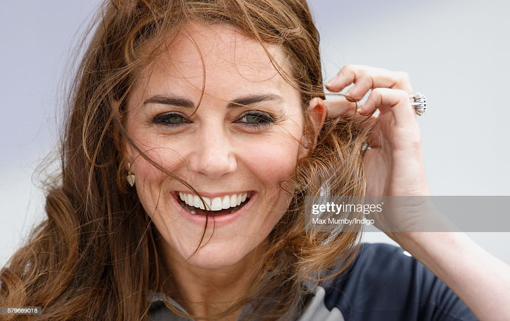 Catherine, Duchess of Cambridge's hair is blown in the wind as she visits Land Rover BAR during the America's Cup World Series on July 24, 2016 in Portsmouth, England.