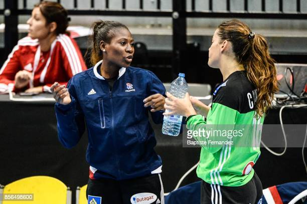 Catherine Gabriel of France talk with Cleopatre Darleux of France during the handball women's international friendly match between France and Brazil...