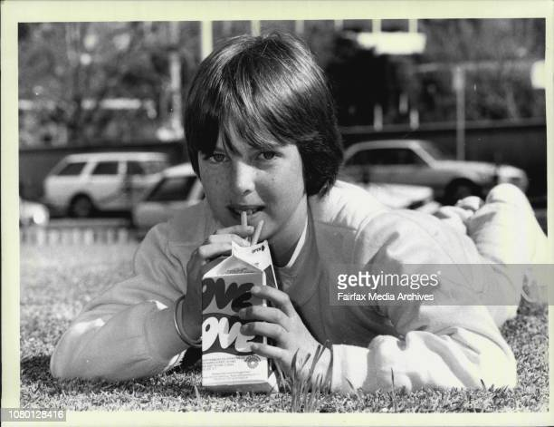 Catherine Gann from South Grafton enjoying a carton of Flavoured Milk which was hit by the budget Catherine is pix a railway Square August 20 1986