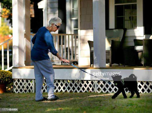 Catherine Greig, the former longtime girlfriend of mobster Whitey Bulger, walks her dog in Hingham, MA on Sept. 25, 2019 on the front lawn of the...