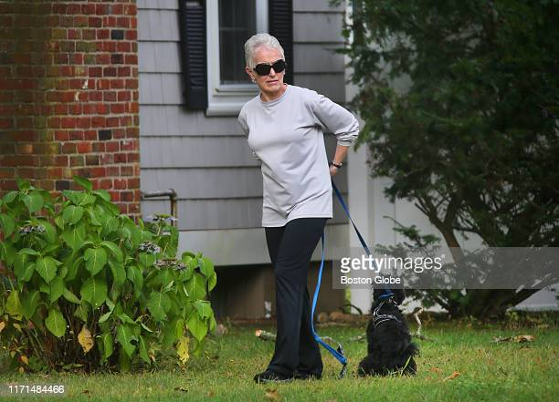 Catherine Greig, the former longtime girlfriend of mobster Whitey Bulger, walks her dog in Hingham, MA on Sept. 26, 2019 on the front lawn of the...