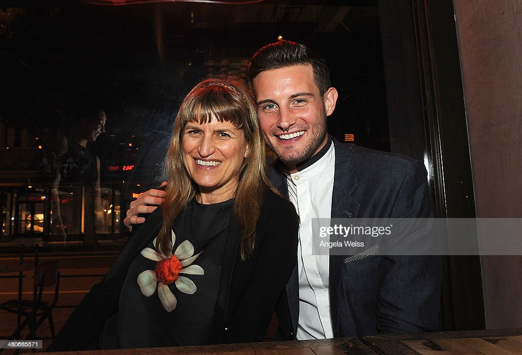 Catherine Hardwicke and Nico Tortorella attend the premiere after party of A24's 'Under The Skin' at Umami Burger on March 25, 2014 in Los Angeles, California.
