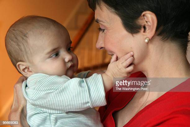 Catherine Herridge with her infant son Peter Hayes 8 mos old PICTURED Catherine Herridge holds her son in their Washington DC home