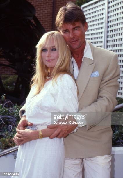 Catherine Hickland with JanMichael Vincent from a publicity shoot for AIRWOLF Season 3 premiere 'The Horn Of Plenty' in August 1985 in Los Angeles...