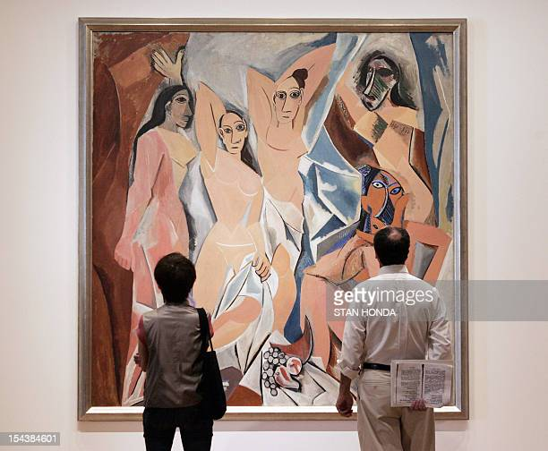 Catherine HOURS US Two people view Pablo Picasso's Les Demoiselles d'Avignon on display 09 May 2007 at the Museum of Modern Art in New York as part...