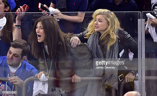 Catherine Keener and Chloe Grace Moretz attends the Pittsburgh Penguins vs New York Rangers playoff game at Madison Square Garden on April 18 2015 in...