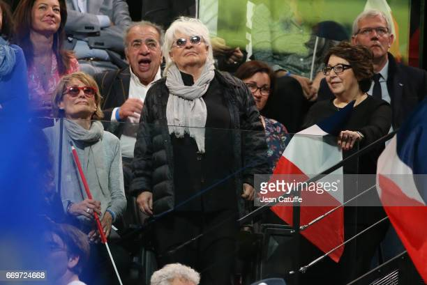 Catherine Lara her partner Samantha Corinne Lepage architect Roland Castro attend the campaign rally of French presidential candidate Emmanuel Macron...