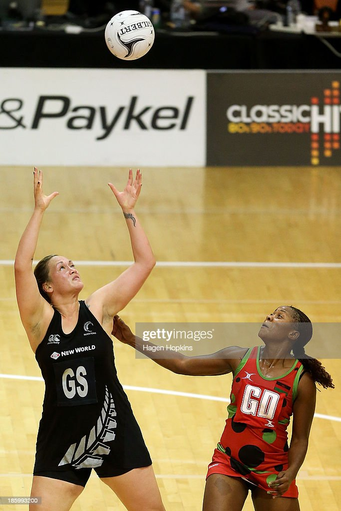 Catherine Latu of New Zealand and Caroline Mtukule of Malawi compete for the ball during the International Test Match between the New Zealand Silver Ferns and the Malawai Queens at Pettigrew Green Arena on October 27, 2013 in Napier, New Zealand.