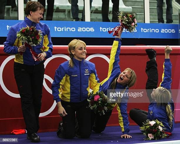 Catherine Lindahl Anna Svaerd Ulrika Bergman and Eva Lund of Sweden celebrate winning gold during the gold medal match of the women's curling between...