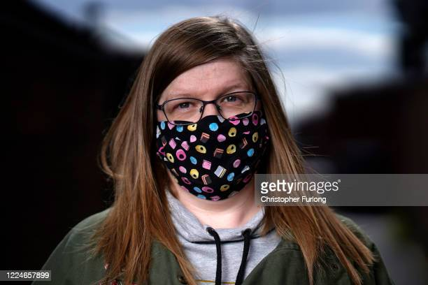 Catherine Logan poses wearing her face mask as she goes about essential chores on May 13 2020 in Darlaston West Midlands United Kingdom People are...
