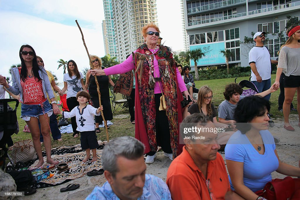 Catherine Madden holds a stick as she and others participate in a sacred 12.12.12 ceremony with ancient crystal skulls at Miami Circle which is a Tequesta indian site used centuries ago on December 12, 2012 in Miami, United States. The ceremony was held on the calender date of 12-12-12 which is the last major numerical date using the Gregorian or Christian calendar for almost another century.
