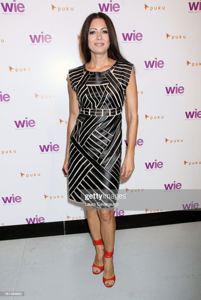 Catherine Malandrino attends day 2 of the 4th Annual WIE Symposium at Center 548 on September 21, 2013 in New York City.