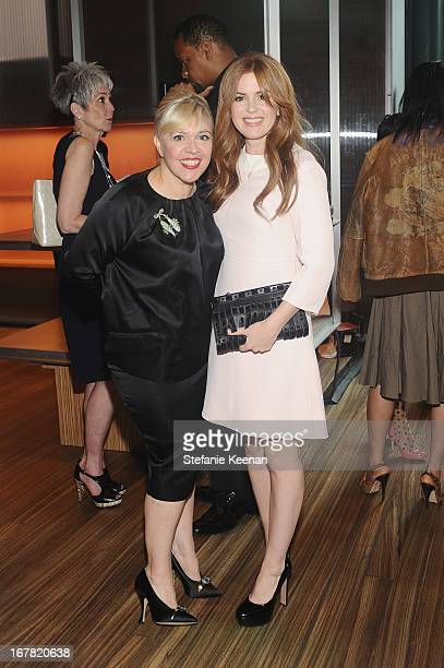 Catherine Martin, Academy Award winning costume and production designer and actress Isla Fisher, wearing Prada, attend Catherine Martin And Miuccia...