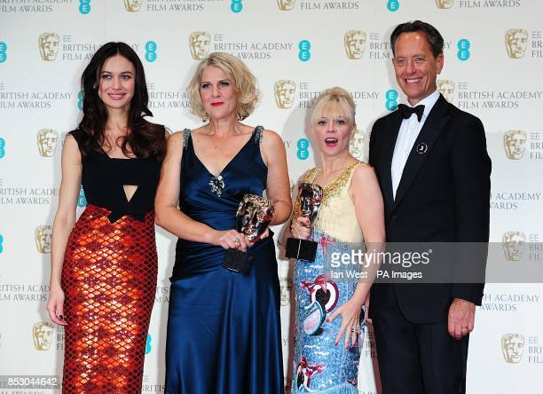Catherine Martin and Beverley Dunn with the award for Production Design 'The Great Gatsby' along with presenters Olga Kurylenko and Richard E Grant...