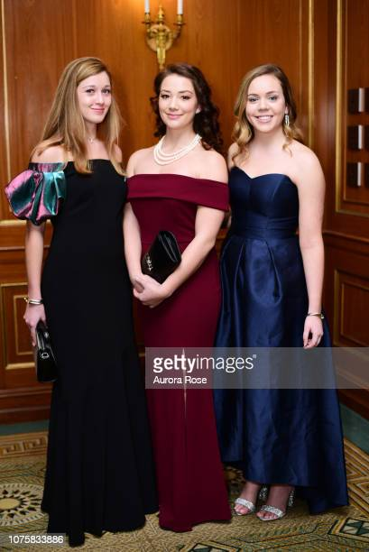 Catherine Maybank Lauren Higgins and Sarah Gaffigan attend The International Debutante Ball at The Pierre Hotel on December 29 2018 in New York City
