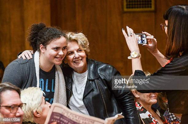 Catherine Mayer takes a photo of Sandi Toksvig and an audience member at the Women's Equality Party policy launch on October 20 2015 in London...