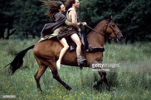 Catherine McCormack and Mel Gibson on horseback together in a scene from the film 'Braveheart' 1995