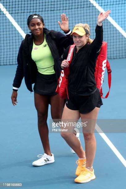 Catherine McNally and Cori Gauff of USA wavew to the crowd following their doubles match against Jessica Moore and Arina Rodionova of Australia...