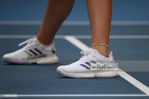 Catherine McNally of the US wearing a handwritten number on her shoe of NBA star Kobe Bryant's Los Angeles Lakers jersey play along with her teammate...