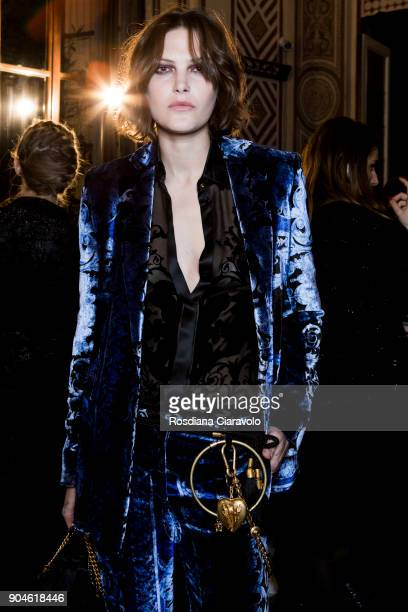 Catherine McNeil is seen ahead of the Versace show during Milan Men's Fashion Week Fall/Winter 2018/19 on January 13 2018 in Milan Italy