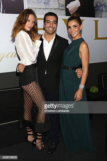 Catherine McNeil Mohammed Al Turki and Clotilde Courau attend the amfAR Milano 2014 Cocktail as part of Milan Fashion Week Womenswear Spring/Summer...