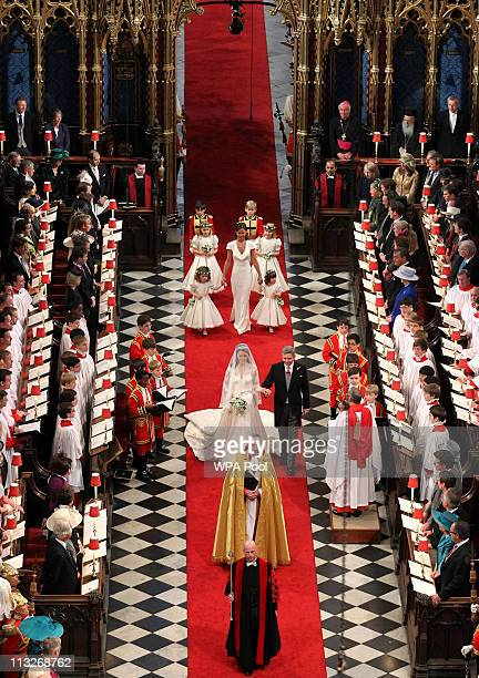 Catherine Middleto walks up the aisle with her father Michael Middleton inside Westminster Abbey on April 29 2011 in London England The marriage of...