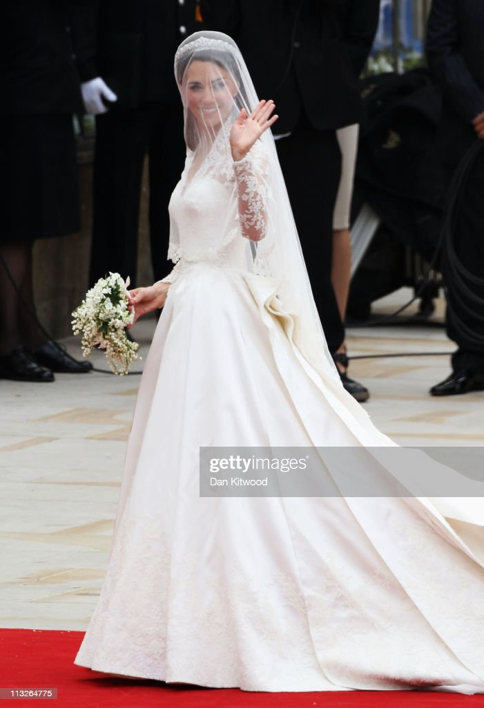 Catherine Middleton waves as she arrives for the Royal Wedding of Prince William to Catherine Middleton at Westminster Abbey on April 29, 2011 in London, England. The marriage of the second in line to the British throne is to be led by the Archbishop of Canterbury and will be attended by 1900 guests, including foreign Royal family members and heads of state. Thousands of well-wishers from around the world have also flocked to London to witness the spectacle and pageantry of the Royal Wedding.
