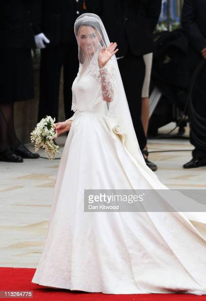Catherine Middleton waves as she arrives for the Royal Wedding of Prince William to Catherine Middleton at Westminster Abbey on April 29 2011 in...
