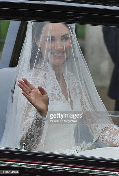 Catherine Middleton waves as she arrives for the Royal Wedding of Prince William to Catherine Middleton at Westminster Abbey on April 29, 2011 in...