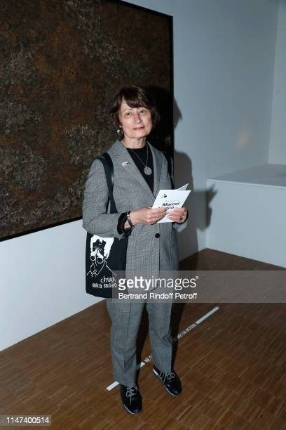 Catherine Millet poses in front of a work of painter Jean Dubuffet during the Prehistoire une enigme moderne Exhibition at Centre Pompidou on May 06...