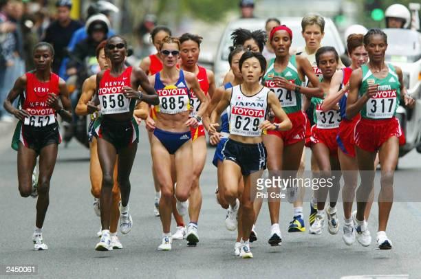 Catherine Ndereba of Kenya and Mizuki Noguchi of Japan lead the pack during the women's marathon at the 9th IAAF World Athletics Championship at the...