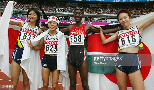 Catherine Ndereba of Kenya celebrates winning the women's marathon final next to Japanese Mizuki Noguchi Naoko Sakamoto and Masako Chiba at the 9th...