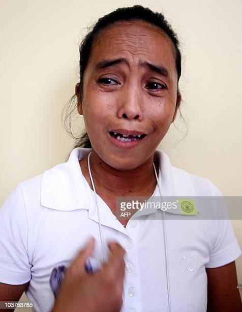 Catherine Nunez the 48 yearold mother of one of the victims of a political massacre in the southern Philippines last year cries in Manila on...