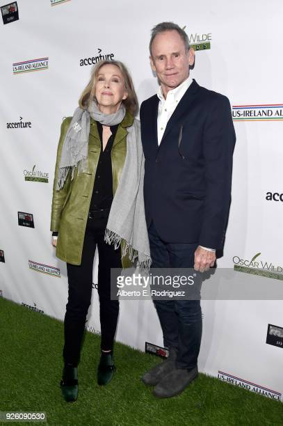 Catherine O'Hara and Bo Welch attend the Oscar Wilde Awards 2018 at Bad Robot on March 1 2018 in Santa Monica California