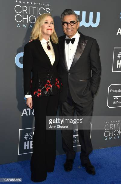 Catherine O'Hara and Eugene Levy attend the 24th Annual Critics' Choice Awards at Barker Hangar on January 13 2019 in Santa Monica California