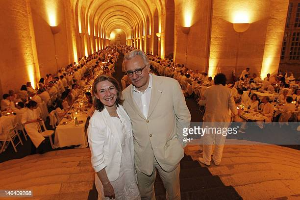 Catherine Pegard President of the Palace of Versailles stands alongside French chef Alain Ducasse after signing an agreement for him to use fruits...