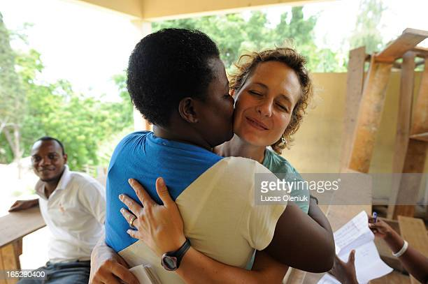 Catherine Porter is embraced by Roselene Derival Fabre after Porter donated money to her PortauPrince school